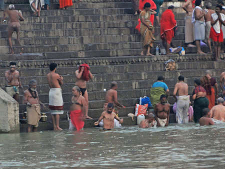 ritual: VARANASI, INDIA - NOV 6 -  Hindus perform ritual puja at dawn in the Ganges River  on Nov 6, 2009,  in Varanasi, India.     Editorial