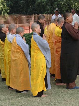 sarnath: SARNATH, INDIA - NOV 6  - Japanese monks and nuns perform Buddhist rituals on Nov 6, 2009, at Dharmeka Stupa at Sarnath,  India