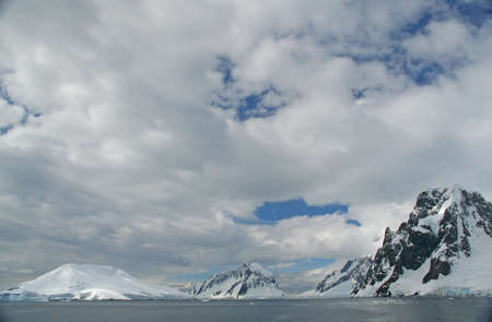 Icefall and glacier carved mountains and ridges, Petermann Island,Antarctica