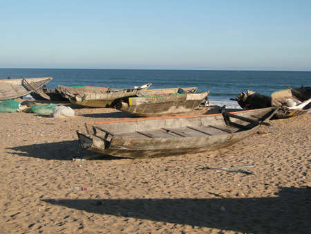 beached: Wooden fishing boats beached for the night                            Stock Photo