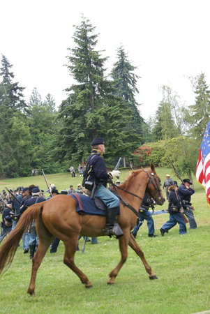 civil war: PORT GAMBLE, WA - JUN 20  -   Union cavalry patrols the field during a mock Civil War battle  on Jun 20, 2009 in Port Gamble WA