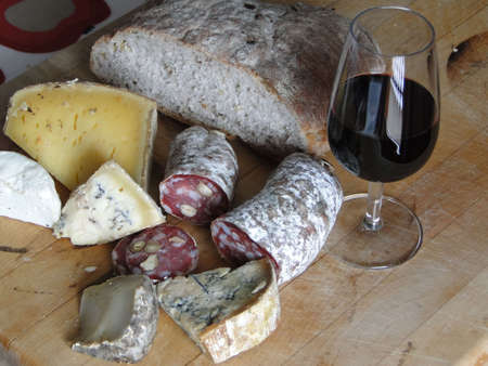 Glass of red wine, salami, cheese and whole grain bread, still life,   Chatel,  France
