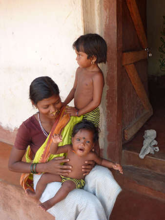 ORISSA INDIA - Nov 11 - Tribal woman poses with her children   on Nov 11, 2009 in Orissa, India