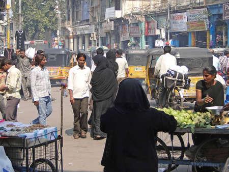 HYDERABAD, INDIA - NOV 21 - Veiled muslim women shop in the Lad Bazaar on Nov 21, 2009 in Hyderabad, India
