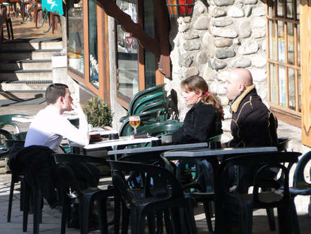 PORTES DU SOLEIL, FRANCE - Feb 28 -  Apres ski - skiers relax in an  outdoor tavern after a day of skiing on Feb 28, 2010 in Chatel, France