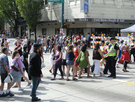 SEATTLE - MAY 15 -  A policeman directs traffic  at the U District Street Fair on May 15, 2010, in Seattle