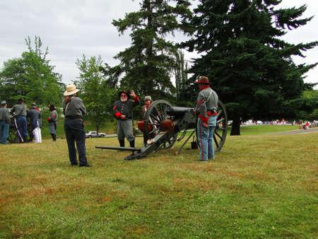PORT GAMBLE, WA - JUN 20  - Confederate artillery man their guns  in a mock battle on Jun 20, 2009 in Port Gamble WA