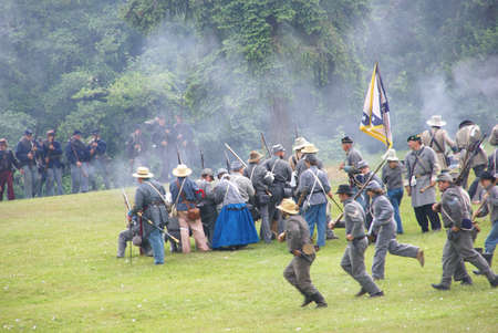 PORT GAMBLE, WA - JUN 20  -  Confederate infantry reinforces their line during a mock Civil War battle on Jun 20, 2009in Port Gamble WA Editorial
