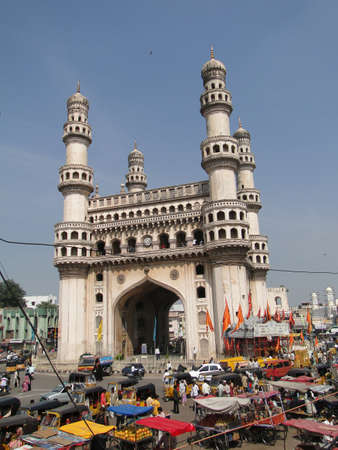 minarets: HYDERABAD, INDIA - NOV 21 - Traffic surrounds the Charminar with its 4 minarets on Nov 21, 2009 in Hyderabad, India Editorial