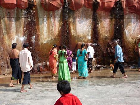 puja: TIRUPATI, INDIA - NOV 26 - Hindu pilgrims gather at a sacred spring and waterfalls for puja on Nov 26, 2009, in Andhra Pradesh, India. Editorial