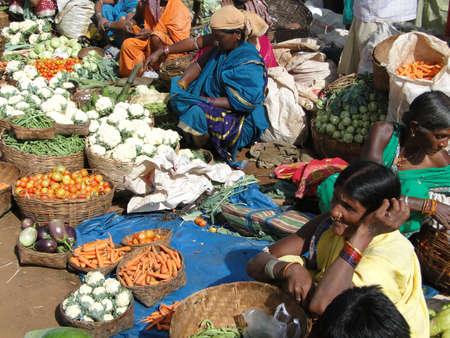 ORISSA, INDIA - NOV 13 -Tribal women sell fresh vegetables  on Nov 13, 2009, in  market, Orissa, India Stock Photo - 7960660
