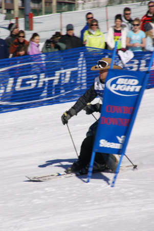 STEAMBOAT SPRINGS COLORADO 20 JAN 2009 -  Cowboy in chaps and stetson skiing the slalom course, Cowboy Downhill, Steamboat Springs Colorado, Rocky Mountains  Stock Photo - 9638450