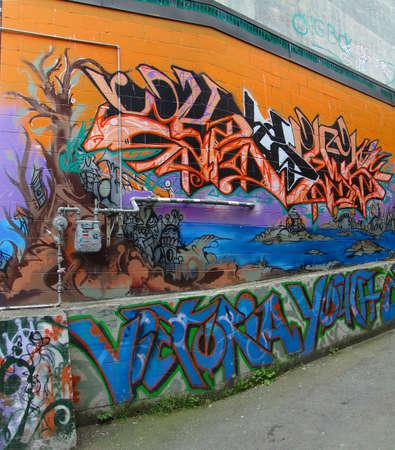 VICTORIA, BC - APR 9 - Urban graffiti murals brighten Old Towns alleys Old Town, on Apr 9, 2011 in Victoria, BC, Canada