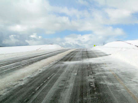 Blue sky and lonely winter highway, near Wolcott, Colorado    Stock Photo - 9747993