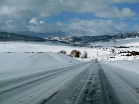 winter road: Blue sky and lonely winter highway, near Wolcott, Colorado