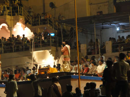 VARANASI, INDIA - NOV 5 - Young Brahmin priests conduct aarti evening service on ghats of the Ganges,  on Nov 5, 2009, in Varanasi, India. Stock Photo - 9678074