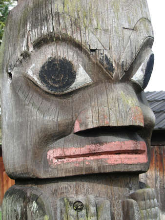 Detail, Totem pole carved from cedar, Thunderbird Park, Victoria, BC, Canada      Stock Photo - 9747221