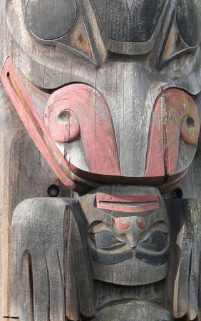northwest indian art: Detail, Totem pole carved from cedar, Thunderbird Park, Victoria, BC, Canada
