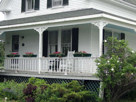 cape cod style: Detail, porch of Classic white New England House, on Mount Desert Island, Acadia National park, Maine, New England