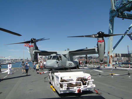 SEATTLE - AUG 4 - Civilians inspect an  MV-22 Osprey,during a tour of the Amphibious Assault Ship Bonhomme Richard, LDH-6,  on Aug 4, 2011, in Seattle. The Osprey is a military, tiltrotor aircraft with both a vertical takeoff and landing (VTOL) and short  Stock Photo - 10268220