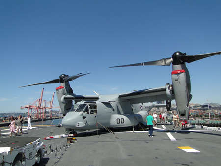 SEATTLE - AUG 4 - Civilians inspect an  MV-22 Osprey,during a tour of the Amphibious Assault Ship Bonhomme Richard, LDH-6,  on Aug 4, 2011, in Seattle. The Osprey is a military, tiltrotor aircraft with both a vertical takeoff and landing (VTOL) and short  Stock Photo - 10290516