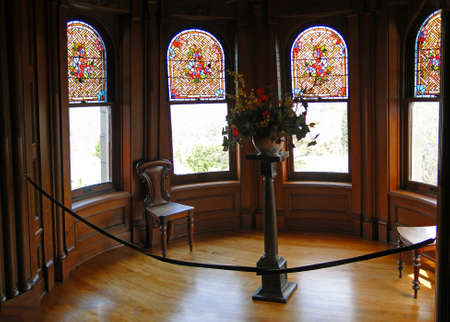 Detail, stained glass windows on staircase landing  at Craigdarroch Castle, Victoria, BC, Canada