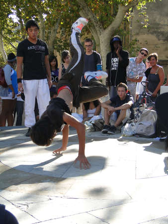 AVIGNON, FRANCE - OCT 1: Hip-Hop breakdancers compete in pairs, on the Plaza of the Palace of Popes, on Oct 1, 2011, in Avignon, France.