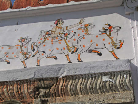 Procession of cows with Divali decorations, temple painting in  Udaipur, India