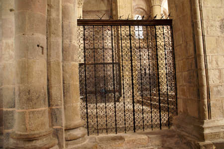Iron gate and columns  of the Abbey Church of St. Foy, Conques, France   photo