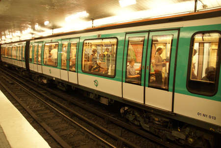 arrives: PARIS - OCT 3 - A Paris Metro train arrives in an underground station  on Oct 3, 2011, in Paris, France.   Stock Photo