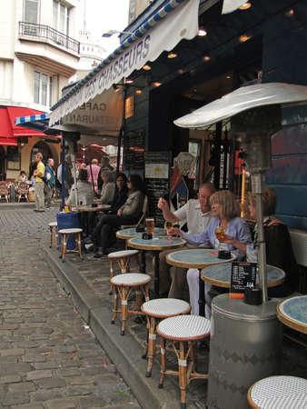 PARIS - SEP 12 - Diners enjoy a lunch at an outdoor bistro  on Sep 12, 2011, in Paris, France.