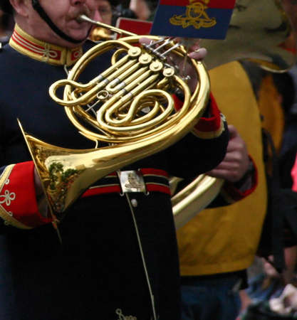 marchers: Horn player,  marching band in blue and red uniforms, Calgary Stampede Parade Calgary Alberta