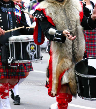 marchers: Kilted drummer in marching band, Calgary Stampede Parade Calgary Alberta