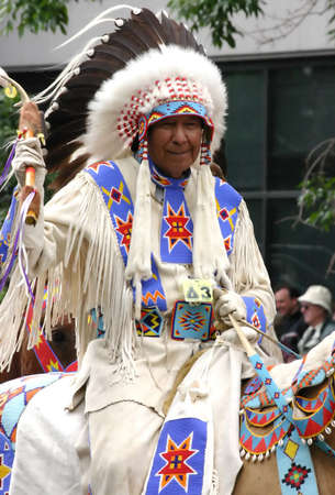 fanfare: Plains Indian chief on horseback,  Calgary Stampede Parade Calgary Alberta  Editorial