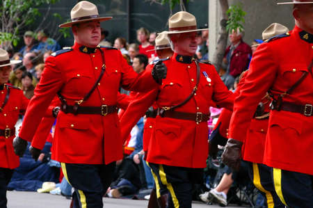 marchers: CALGARY CANADA JULY 2004 -  Royal Canadian Mounted Police, Calgary Stampede Parade, Alberta, Canada