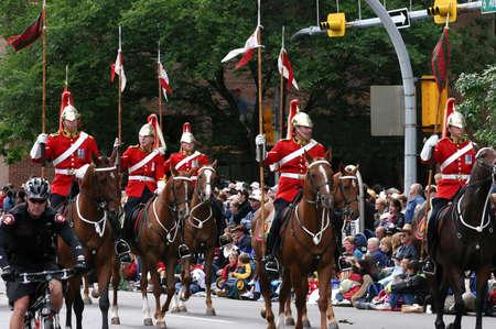 calgary stampede: CALGARY CANADA JULY 2004 -  Red lancers riding in parade,  Calgary Stampede, Alberta, Canada Editorial