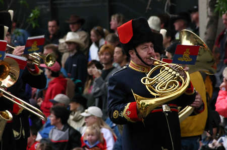 marchers: CALGARY CANADA JULY 2004 -  Horn player in parade,  Calgary Stampede Parade, Alberta, Canada