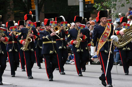 marchers: CALGARY CANADA JULY 2004 -  Marching brass band and drum major,  Calgary Stampede Parade, Alberta, Canada Editorial
