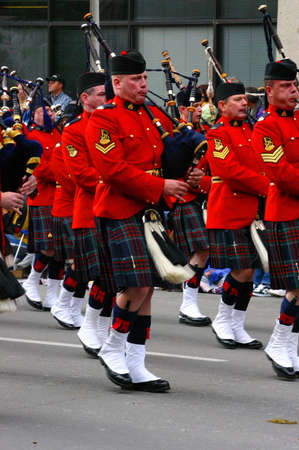 march band: CALGARY CANADA JULY 2004 -  Red Kilted Bagpipe players, Calgary Stampede Parade Alberta
