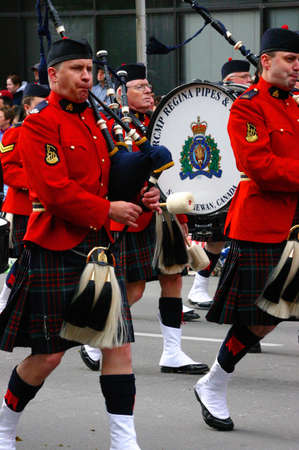 marchers: CALGARY CANADA JULY 2004 -  Red Kilted Bagpipe players, Calgary Stampede Parade Alberta