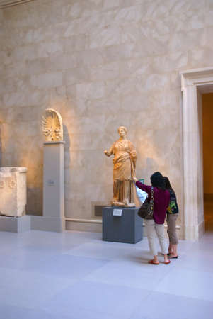 Young Asian women studying statue of Greek goddess, Roman & Greek galleries,