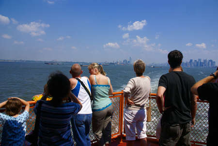 Sightseers, tourists on front of  Staten Island Ferry,  New York City  新聞圖片
