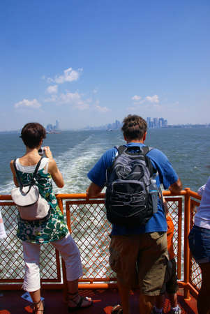 sightseers: Sightseers, tourists on front of  Staten Island Ferry,  New York City  Stock Photo