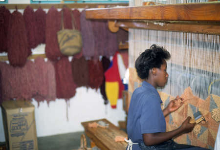 SWAKOPMUND NAMIBIA JUL 1995 - Worker hand weaving a wool carpet,  Karakul Wool factory Swakopmund, Namibia, Africa Stock Photo - 11458471