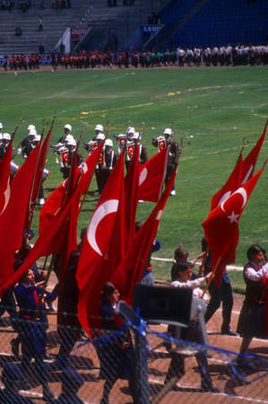 Red Turkish flags carried by school children,  Turkish Independence day celebrations, Erzerum, Turkey, Middle East  Editorial