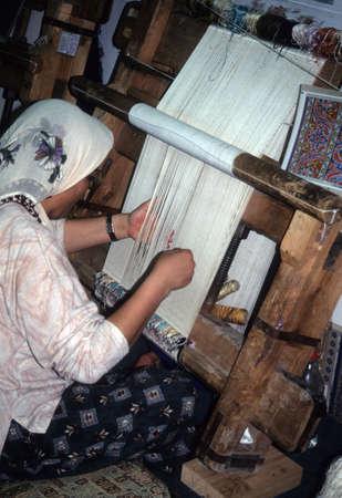 carpet: CAPPADOCIA TURKEY MAY 1999 Woman weaving a carpet on hand loom, Cappadocia, Turkey