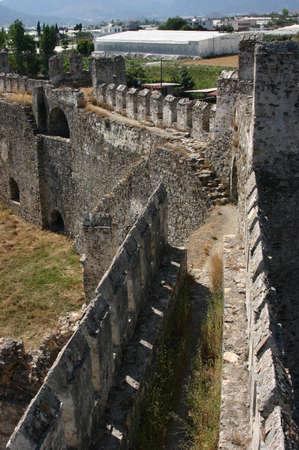 parapet wall: Mumure Castle - crenellations,embrasures,parapet & merlons Anamur Turkey  Stock Photo