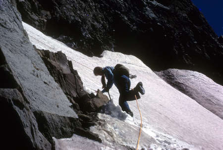 oregon cascades: EUGENE OREGON - AUG 1972 - Young woman descending snowfield on North Sister in the Oregon Cascades