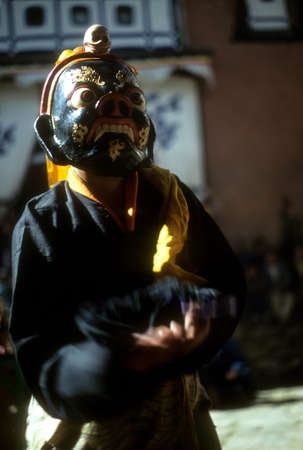 tantric: THYANGBOCHE MONASTERY NEPAL NOV 1979 -  Mani Rimdu dancer, dressed as Tibetan god for harvest festival, Khumbu Himalaya, Nepal, Asia