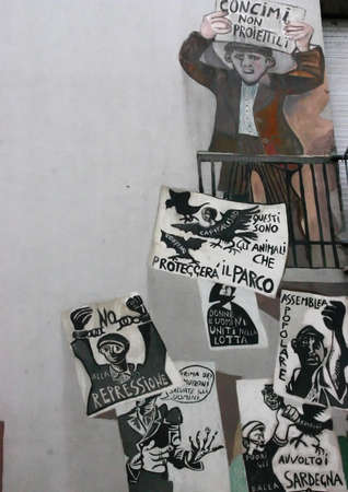 Union protest posters and mural, Orgosolo Sardinia Italy